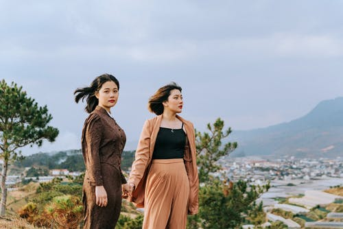 Two Women Standing on Hill