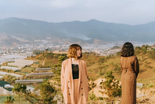 Women Standing On A Hill