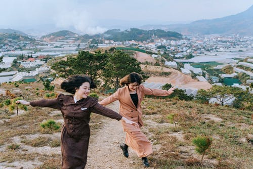 Photo of Women Running Outdoors