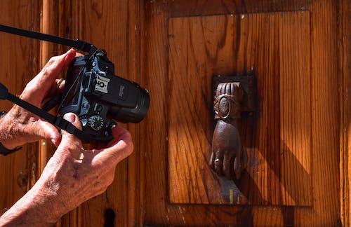 Free stock photo of bronze hand, camera, door, door knocker