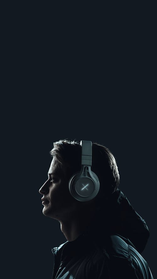 Side View Of A Man With Headphones