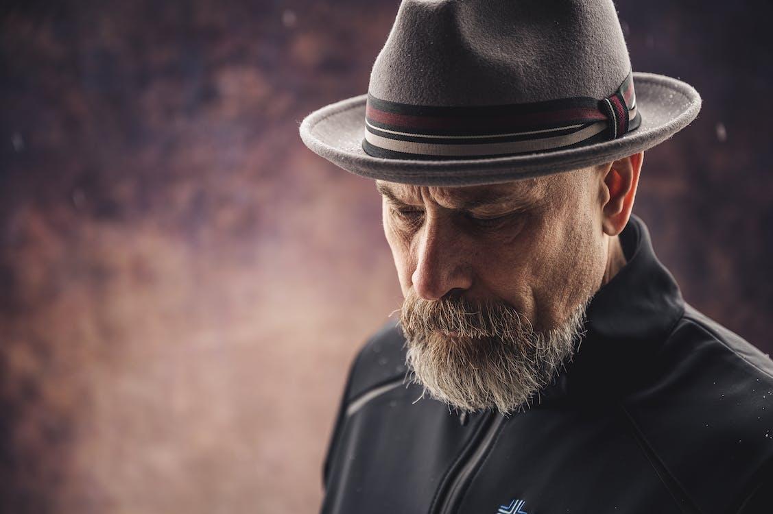Photo Of Man Wearing Brown Fedora Hat