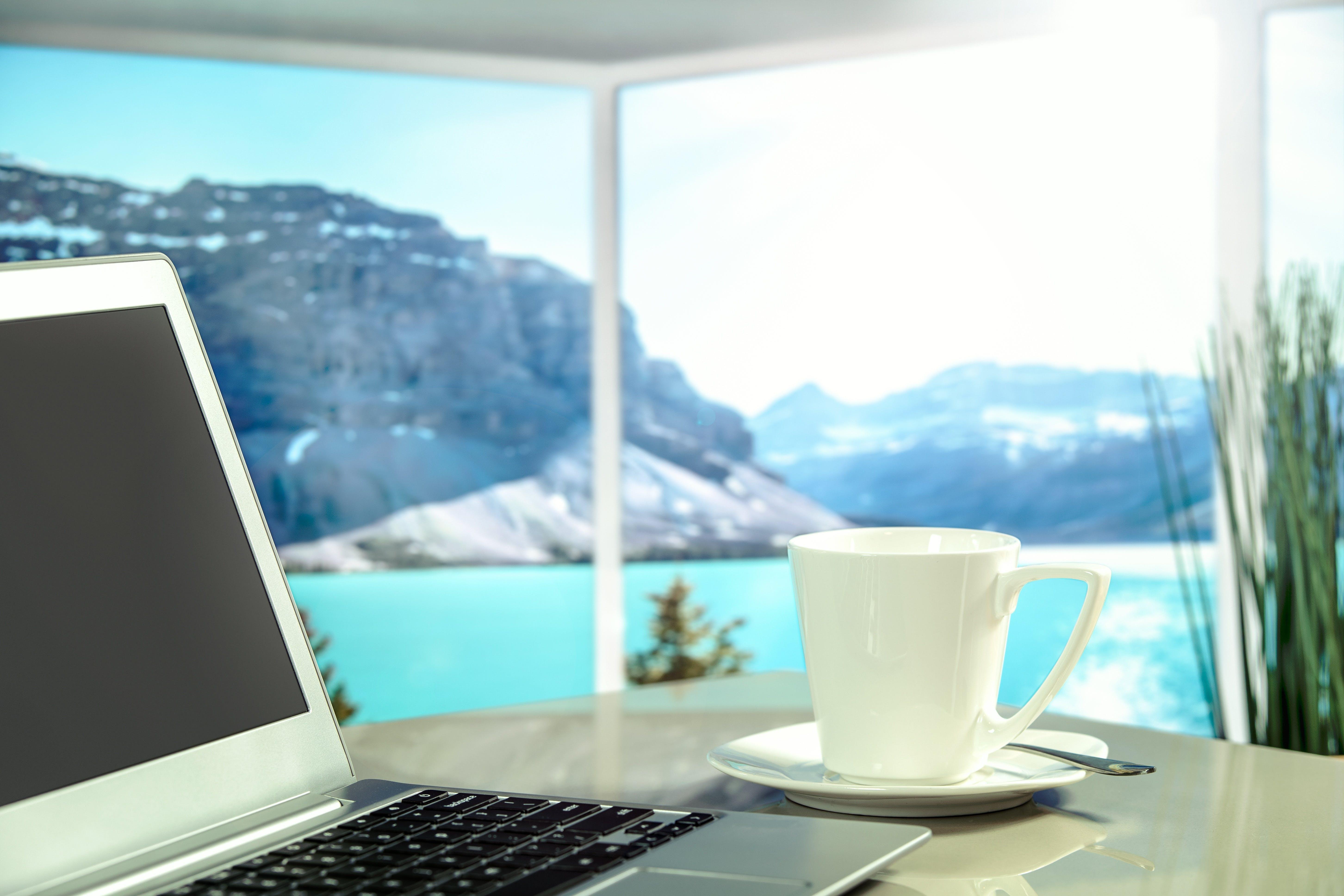 Turned-off Laptop on Table Near Mug