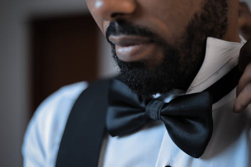 Close-Up Photo of Person Wearing Bow Tie