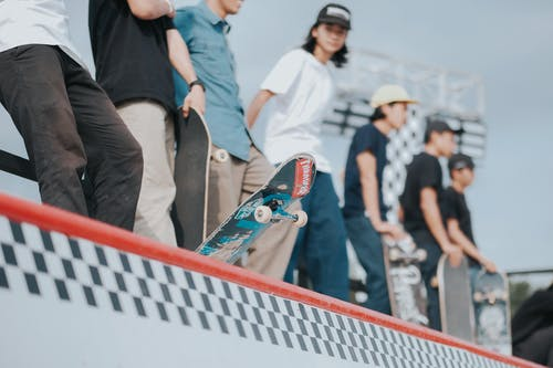 Photo Of People Playing Skateboard