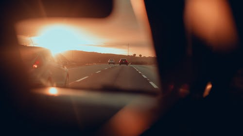 Cars On The Road During Sunset