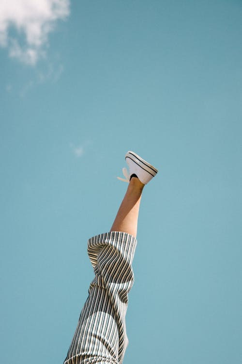 A Person With Foot Up In The Air