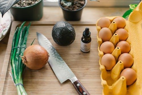 Silver Knife Beside Poultry Eggs