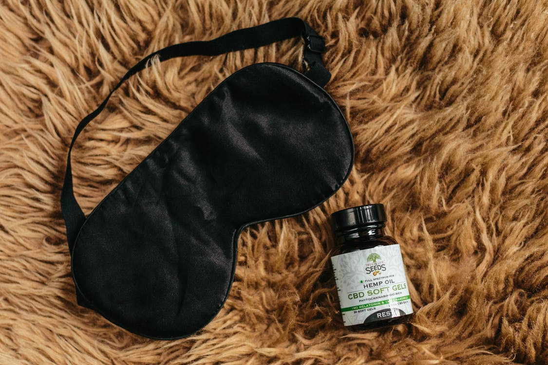 Photo of Hemp Oil Bottle and Eye Mask