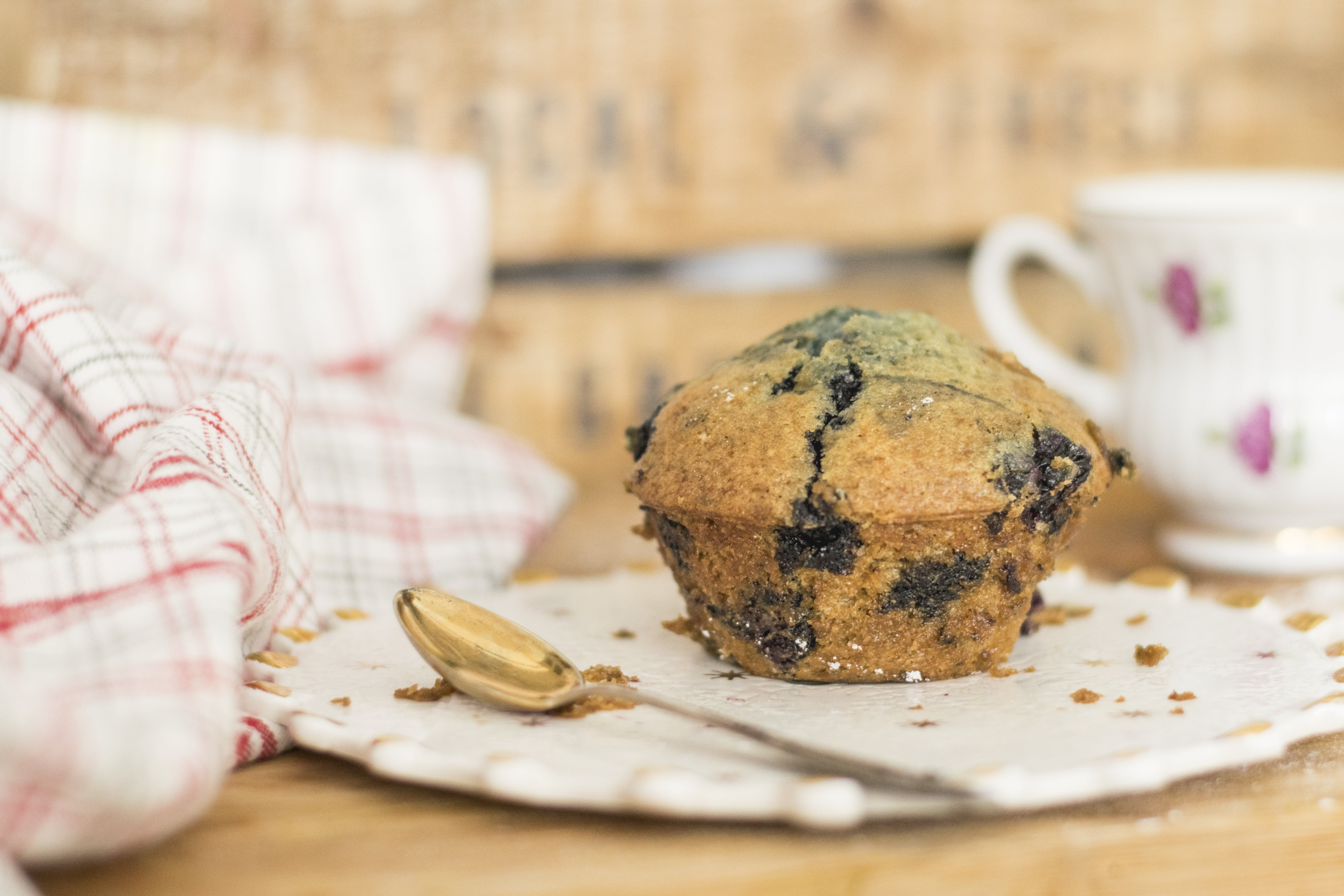 Muffin on Plate Beside Spoon