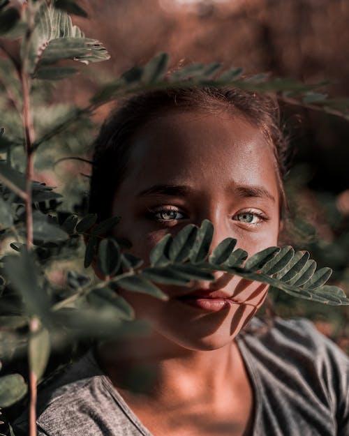 Girl Beside Plant