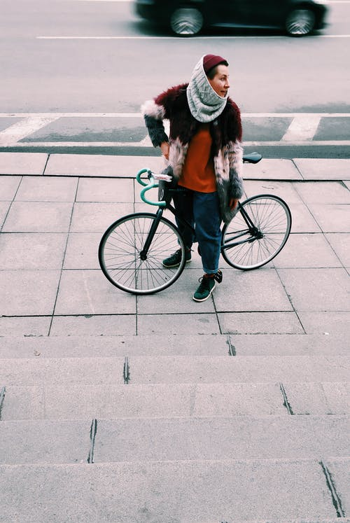 Photography of Person Riding Bicycle