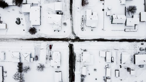 Aerial Photo of Houses Covered with Snow