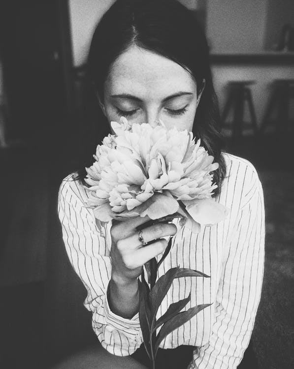 Woman Holding White Flower