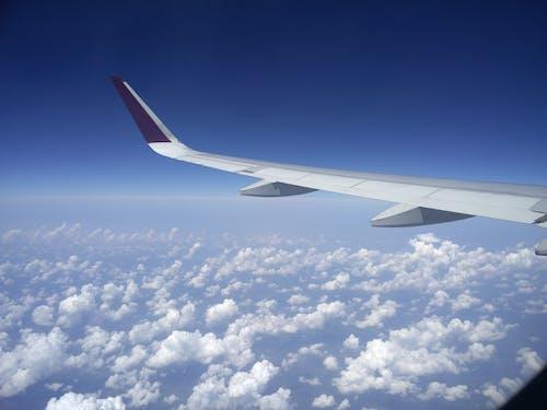 bulutlar, havadan görünüş, kanat içeren Ücretsiz stok fotoğraf