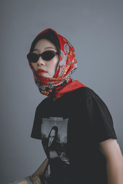 Woman Wearing Black Shirt With Red Scarf