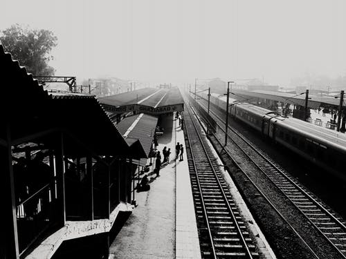 Grayscale Photo of Train Station