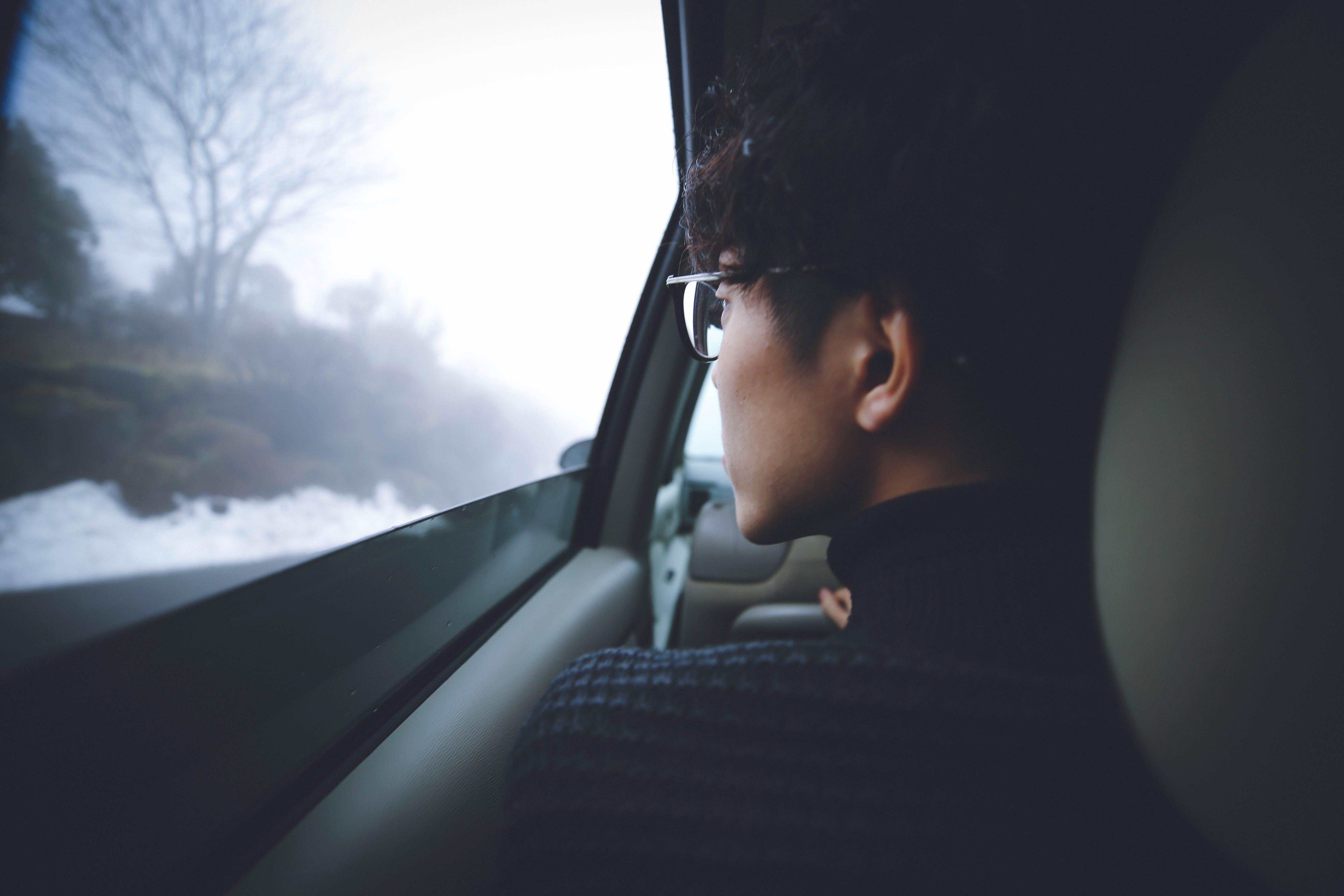 Man Wearing Eyeglasses Inside the Car