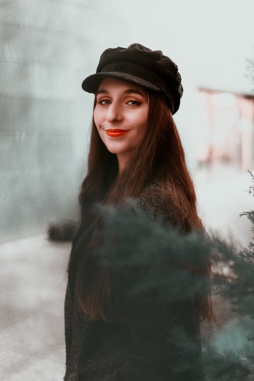 Woman in Black Top and Cap