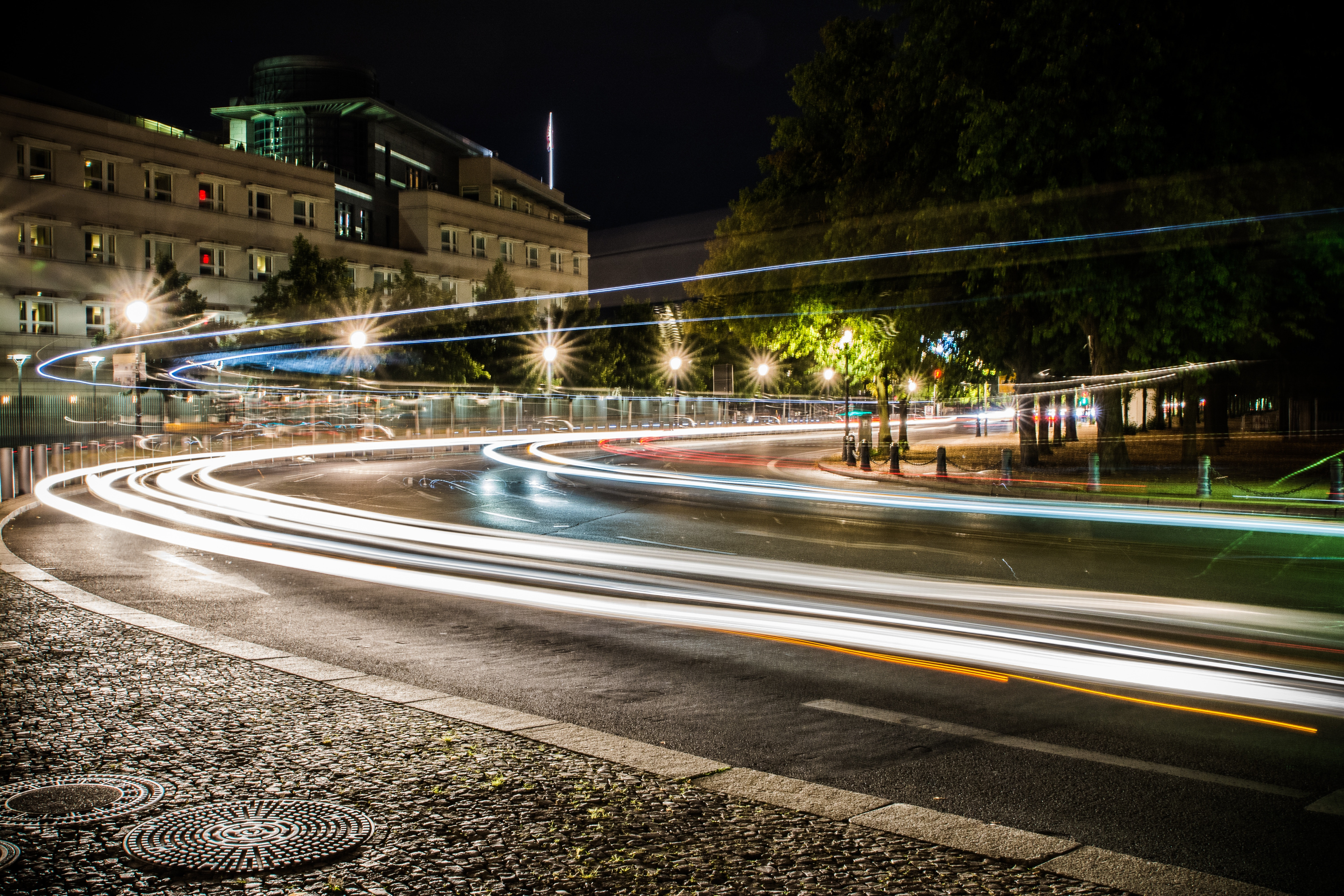 gray concrete road during night time 183 free stock photo