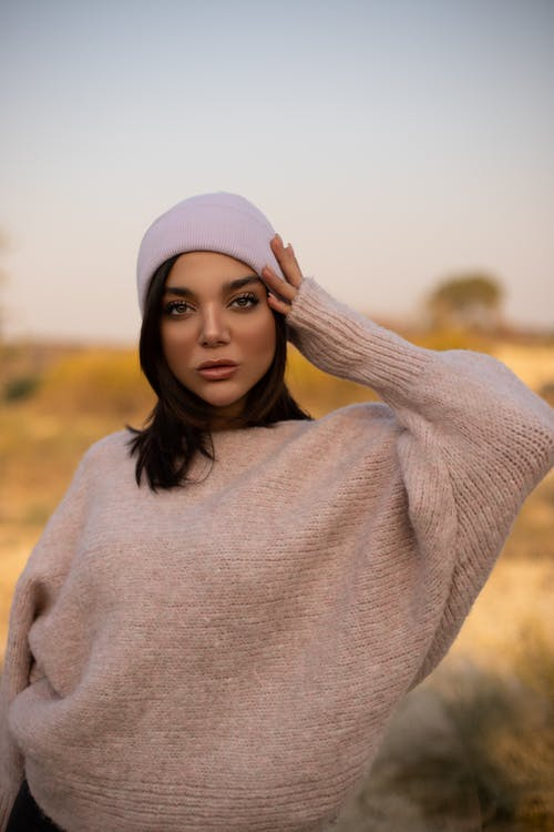 Woman Wearing Sweater and Knit Cap