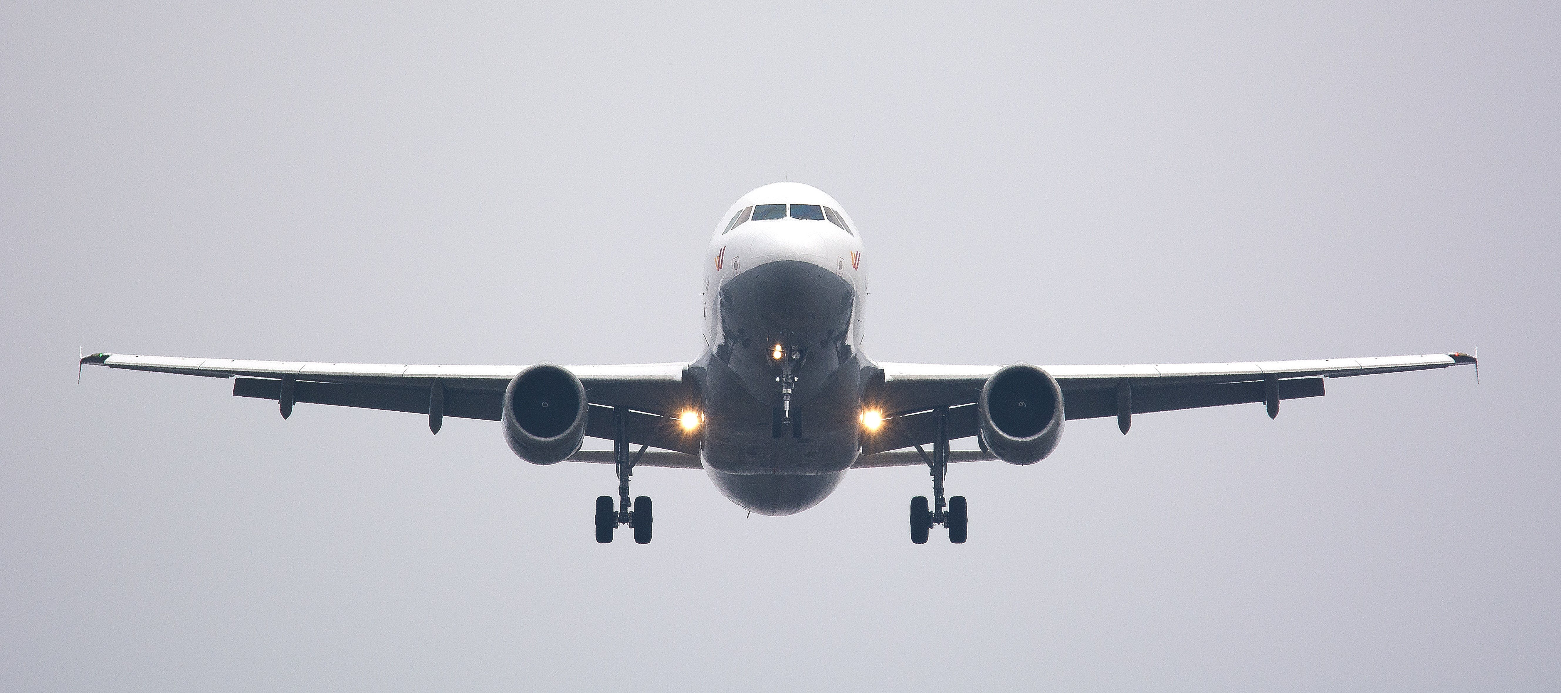 Time Lapse Photography of White Commercial Airplane