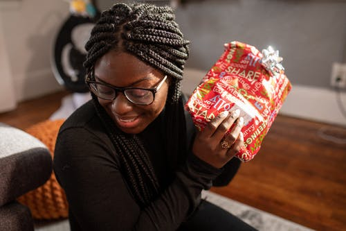 Woman Wearing Black Framed Eye Glasses Holding Red Gift Box