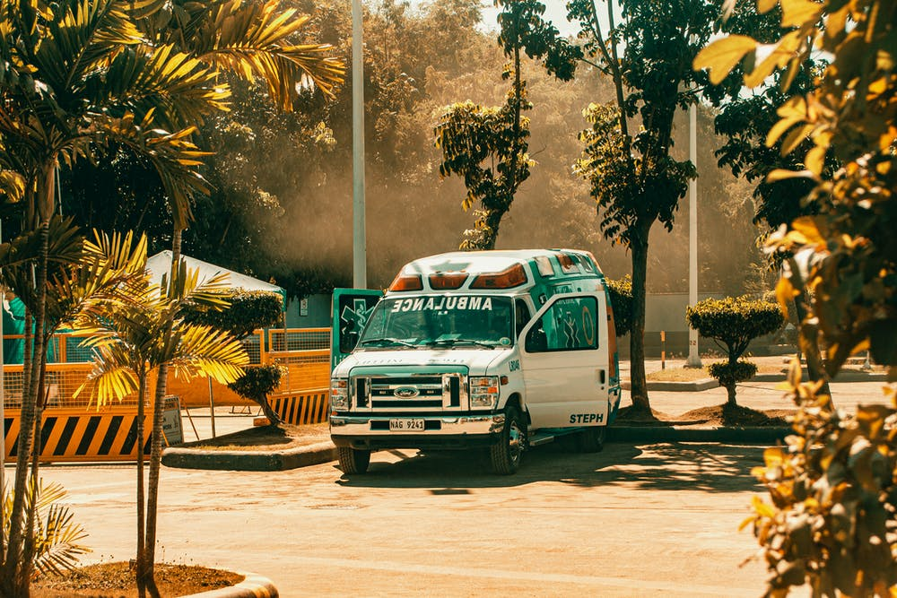 An ambulance in a parking lot. | Photo: Pexels