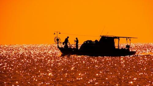 Gratis arkivbilde med appelsin, bakbelysning, båt, daggry