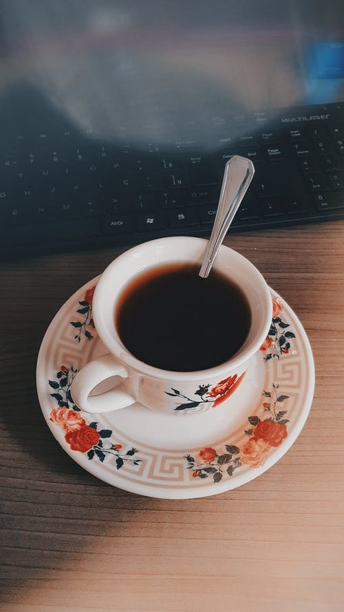 White Ceramic Cup Of Black Coffee