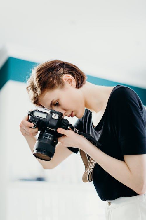 Woman in Black Top Holding Black Dslr Camera