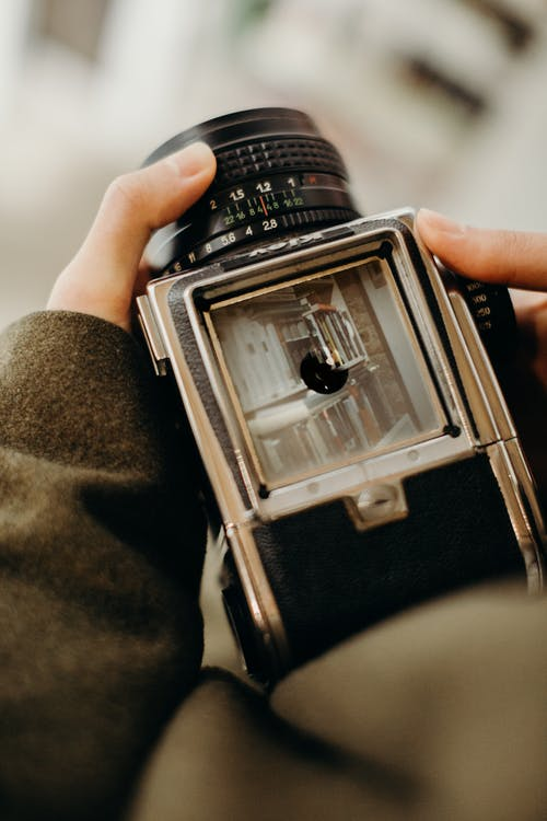 Person Holding Black Film Camera