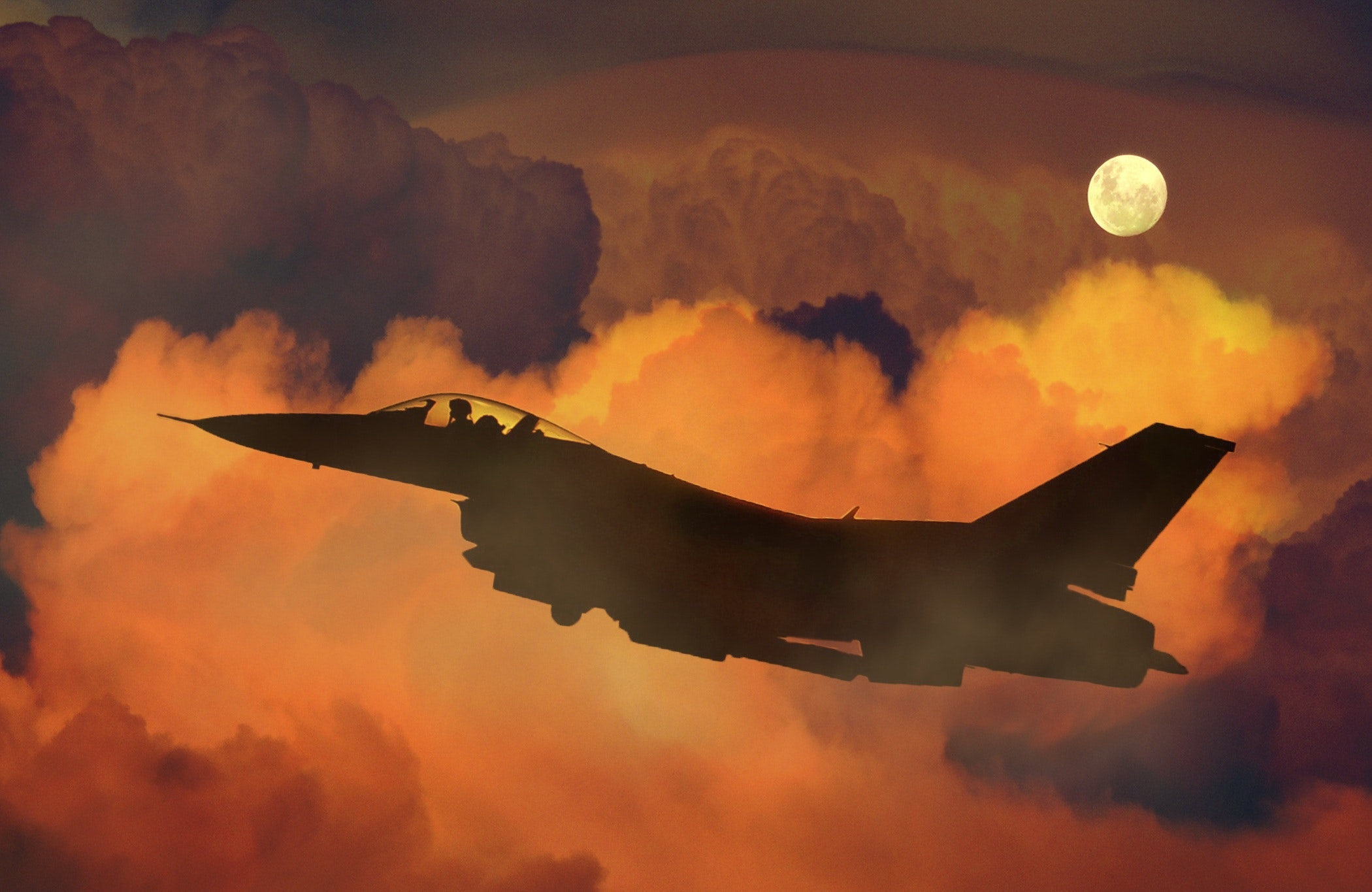 Silhouette Of Fighter Plane Flying Through Clouds  Free Stock Photo-6059