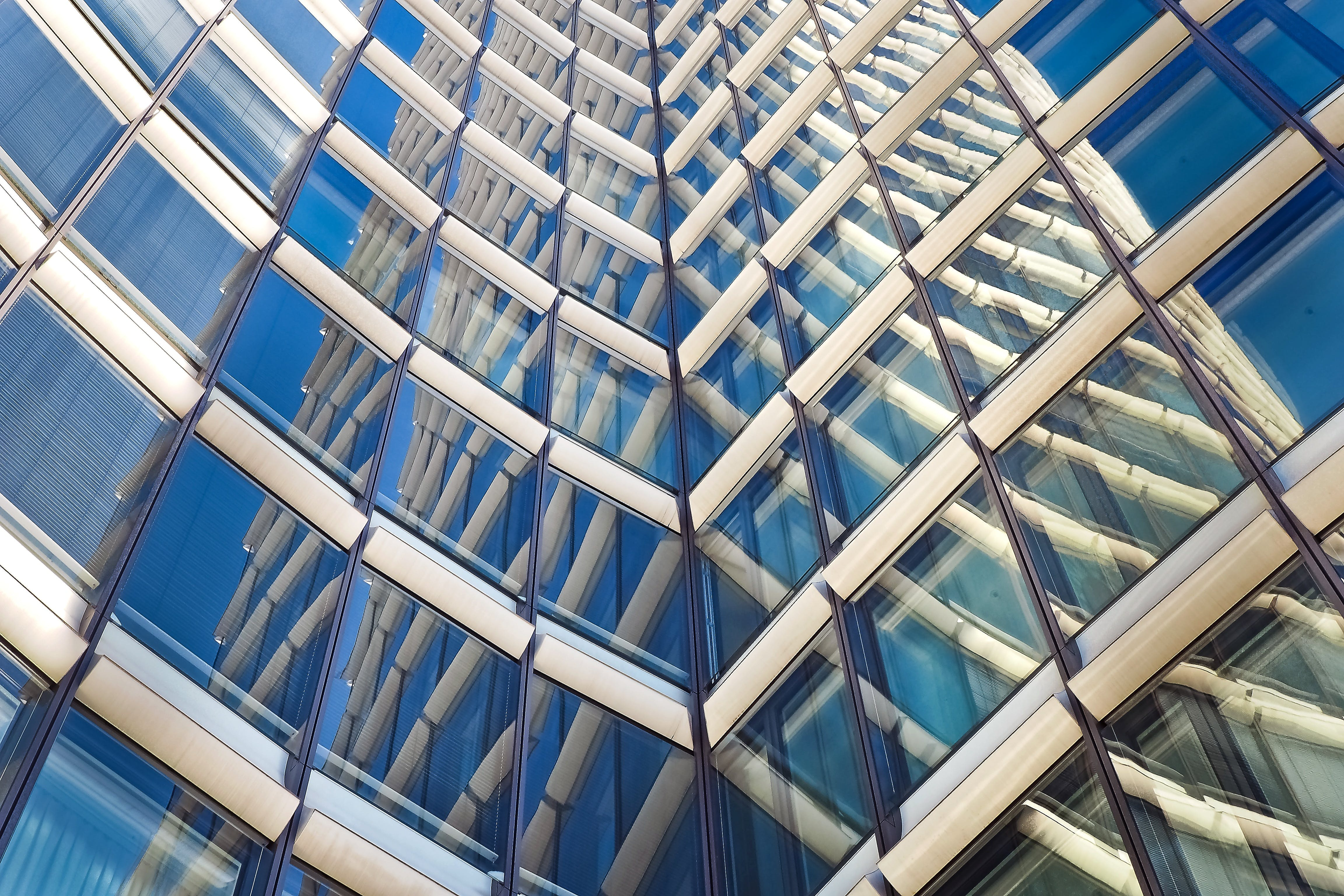 Low-angle Photography of White and Blue High-rise Building