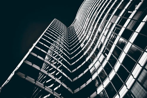 Low-angle Shot Grayscale Photography of Buildings