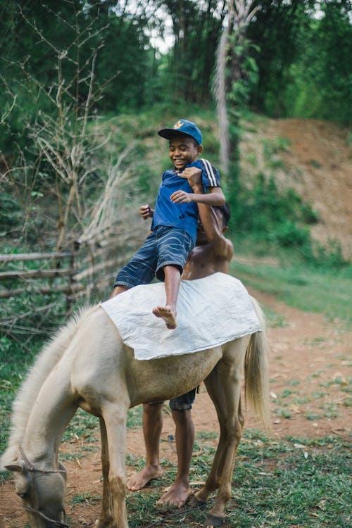 Kid Riding A Horse