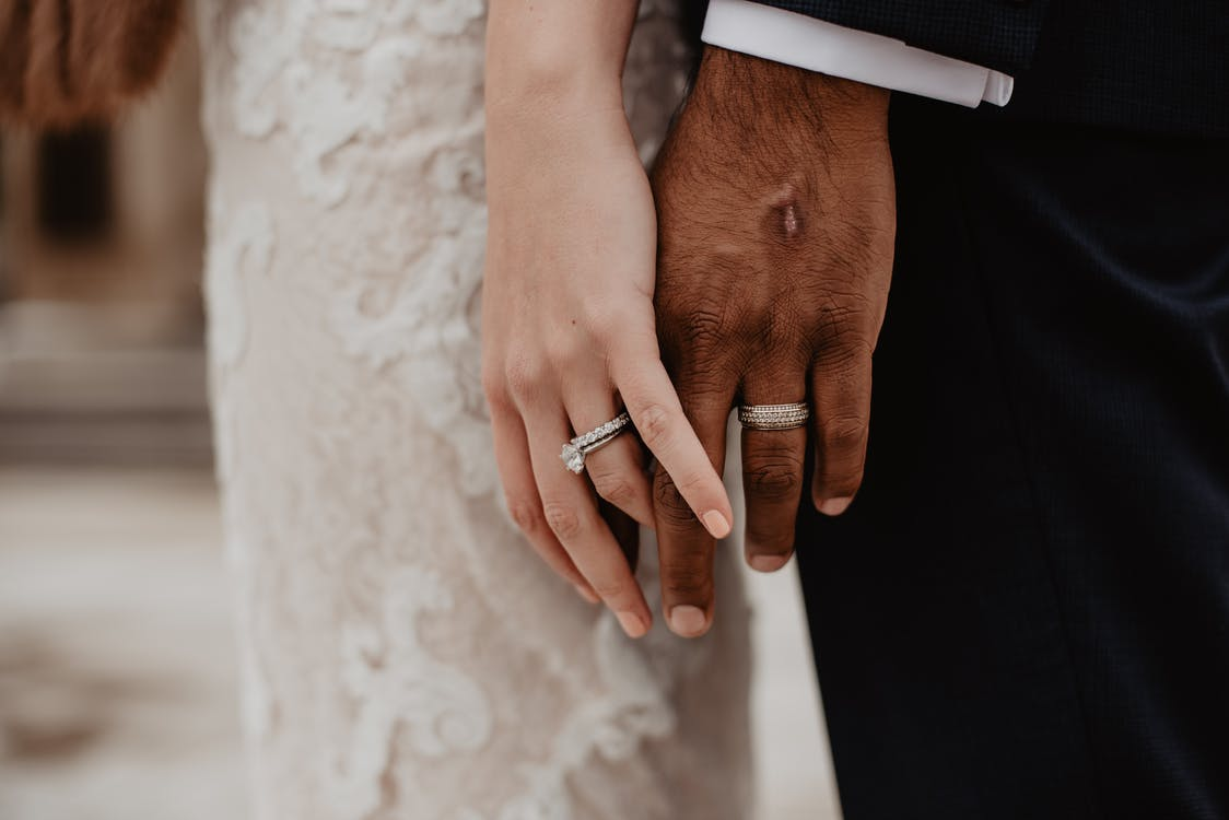 Two Persons Wearing Silver-colored Rings