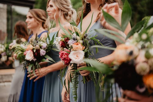 Selective Focus Photography of Women Holding Wedding Flowers