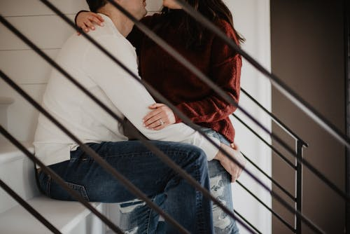 Man and Woman Sitting on Stairs