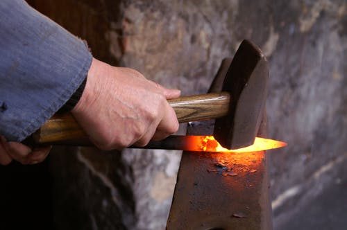 Person Holding Forging Metal