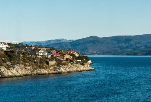 Houses Near Blue Ocean