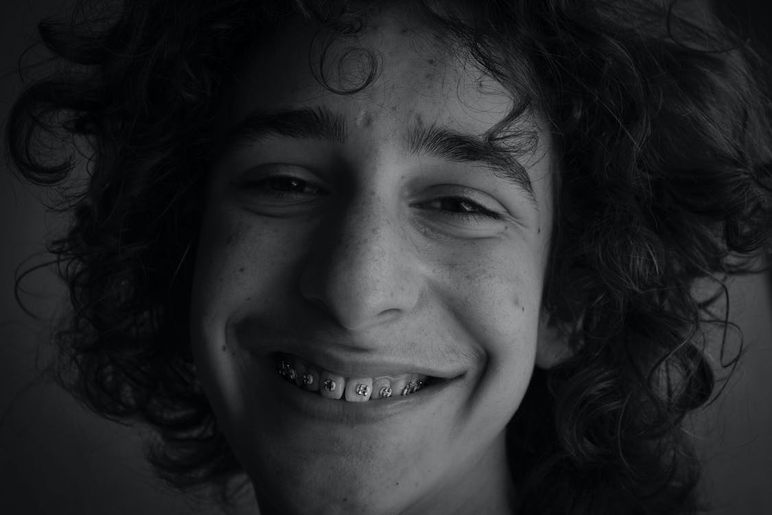 Monochrome Photo of Man Smiling