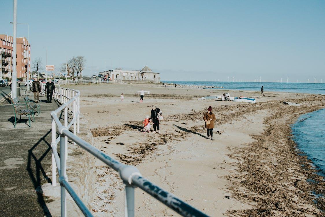 People Walking Near Beach Line