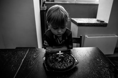 Boy Looking at Birthday Cake