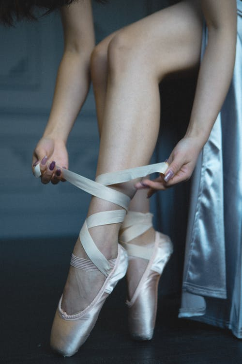 Woman Wearing White Ballet Shoes