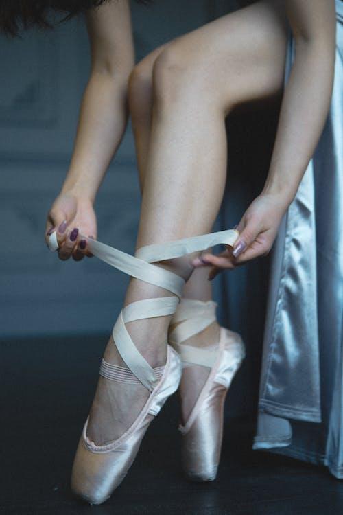 Woman Wearing White Ballet Shoes