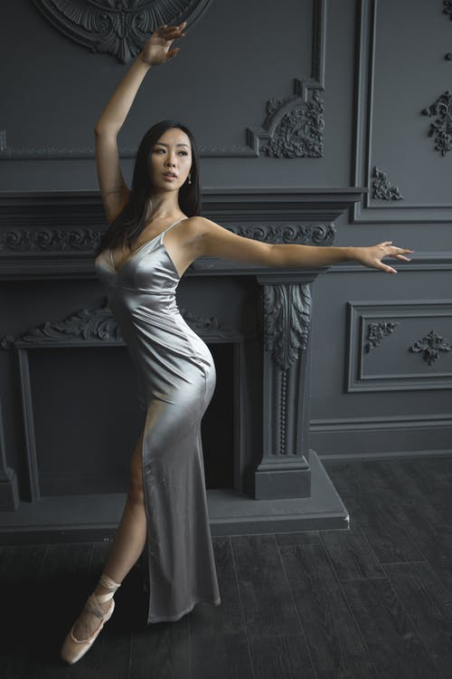 Photo of Woman Wearing Silver Dress