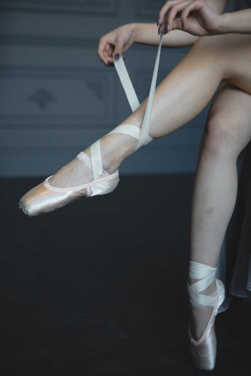 Photo of Person Wearing Ballet Shoes