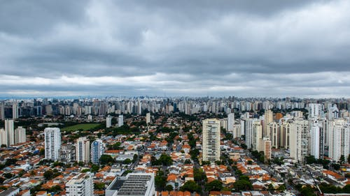 Bird's Eye View Of City Under Cloudy Sky