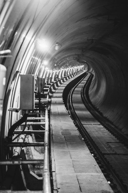 Grayscale Photography of Tunnel